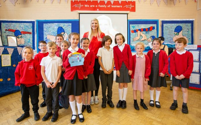 Olympic medalist makes waves when visiting local school