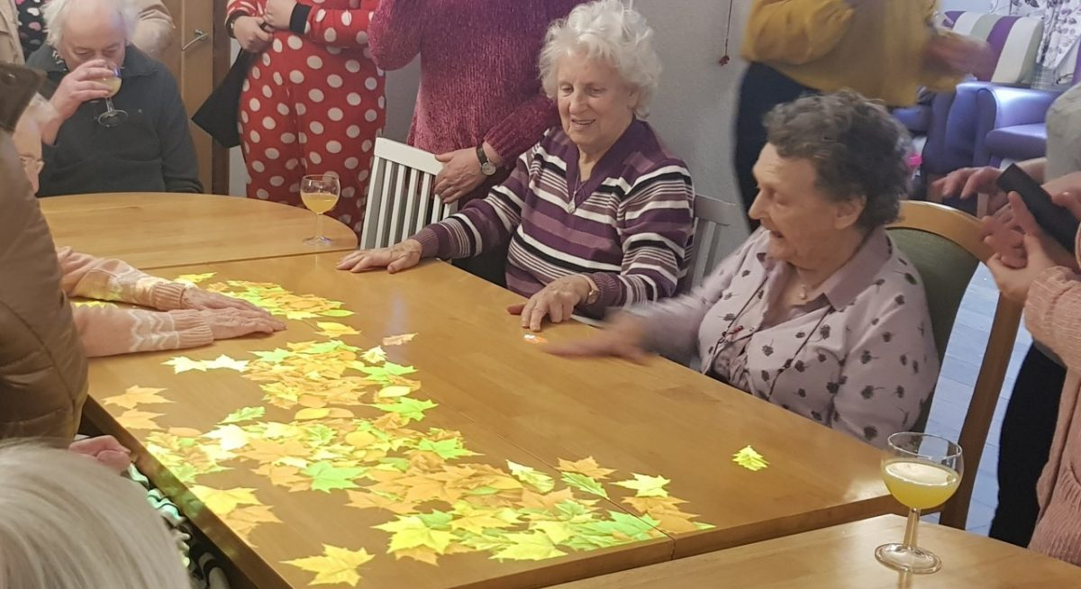 Futuristic 'Magic Table' helping people with dementia at Rugby care home